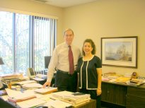 Jennifer Thomas and Gary Chapman in his office.